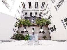 Unsere grüne Balkonterrasse im Innenhof