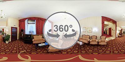 Panorama Aufenthaltsraum mit TV im Hotel Austria Wien